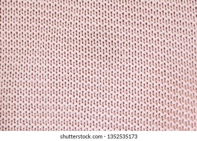 Dark old pink large knit of wool, texture