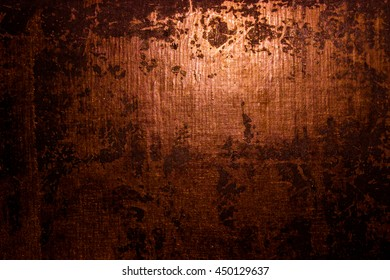 Dark old scary rusty rough golden and copper metal surface texture/background for Halloween or haunted house games background/texture of wall or things