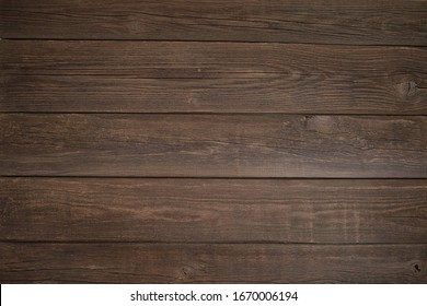 dark old wooden texture with cracks and knots