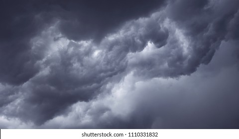 Dark ominous grey storm clouds
