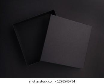 Dark open gift box on a dark background