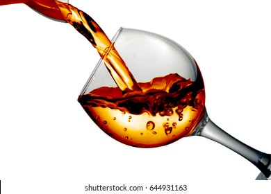 Dark Orange liquid, water, apple juice, white wine pouring into a glass, liquid in a speaker, isolated on a white background