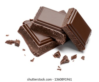 Dark organic chocolate pieces isolated on white background