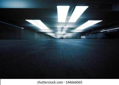 Dark parking garage industrial room interior. Zoom blur perspective.