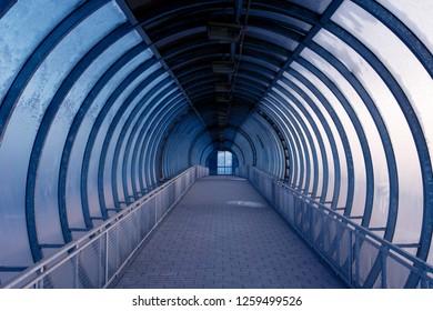 dark pedestrian bridge over the freeway  in Moscow
