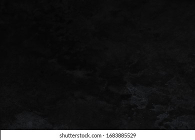 Dark plaster stucco wall background texture.