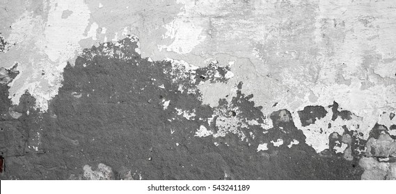 Dark Plaster Wall With Dirty White Black Scratched Horizontal Background. Old Brickwall With Peel Grey Stucco Texture. Retro Vintage Worn Wall Wallpaper. Decayed Cracked Rough Abstract Banner Surface.