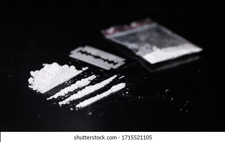 Dark plate with a portion of Cocaine as close-up shot