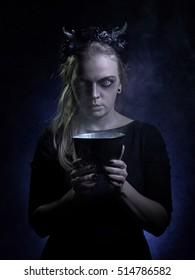 Dark portrait of evil witch in smoke