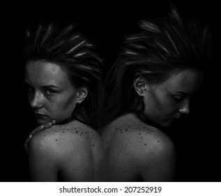 dark portrait of two girls with natural make-up and hairstyle
