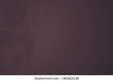 dark purple Cement wall with uneven structures and vermuschutzen and rough spots over the entire image area in industrial design as a background and art design object.
