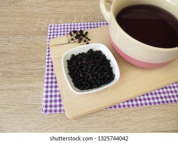 Dark purple dye bath made of dried elderberries