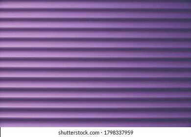 Dark purple siding, metallic striped background, shiny metal fence surface. Convex wall texture. Ribbed blinds, door. Abstract pattern of lines.