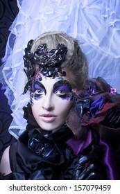 Dark queen. Young woman in creative halloween image.