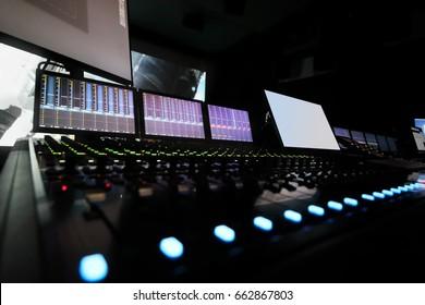 Dark recording studio with modern equipment on movie studio, cinema display out of focus