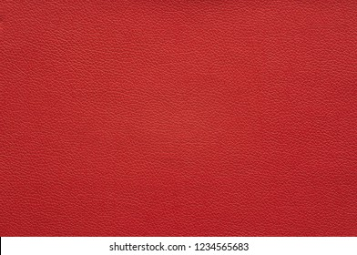 Dark red artificial leather with large texture.
