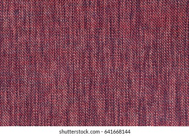 Dark red background with checkered pattern, closeup. Structure of the maroon fabric with natural texture. Cloth backdrop.