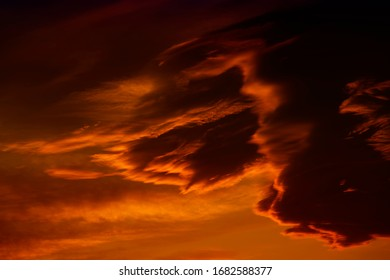 Dark red cloudy sky after sunset. Gloomy atmoshpere.