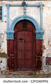 Dark red door in the historic district in Rabat, Morocco