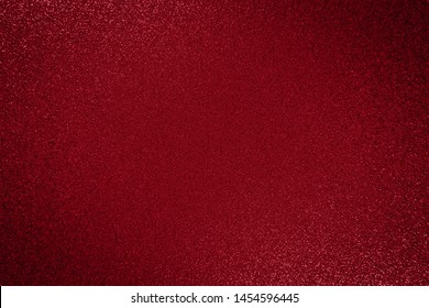 Dark red paper backround, Metallic glitter red background, close up. Dark  paper backround. Black red metallic shimmers background from wrapping paper.  Christmas decorative red card, copy space