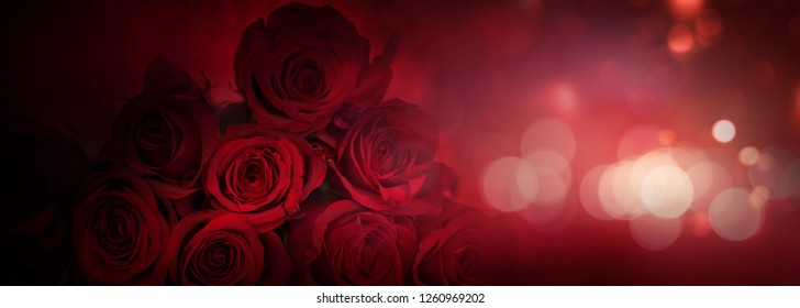 Dark red roses background with bright bokeh for valentine day