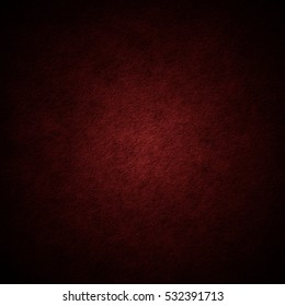 Dark red scratched grunge stucco wall background or texture