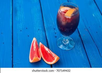 Dark restaurant cocktail with grapefruit