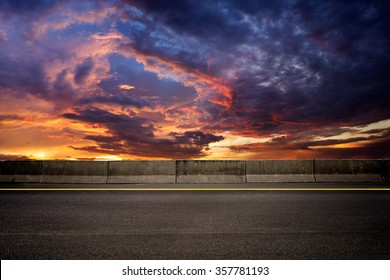 Dark road on sunset setting