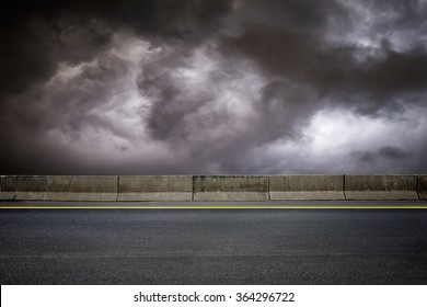 Dark road and dark sky on stormy weather