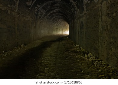Dark road in a tunnel to the light