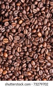 Dark roasted coffee beans texture, overhead, vertical
