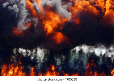 Dark rolling smoke and fire rising from a large explosion