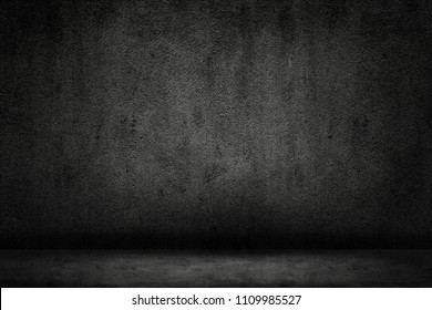 Dark room with floor and concrete wall background
