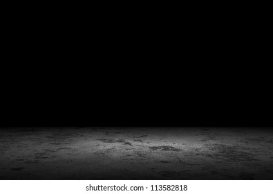 Dark room with grunge floor background
