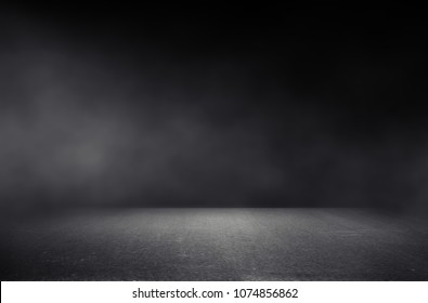 dark room with light and smoke background.