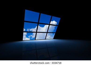 dark room with screens showing a blue sky