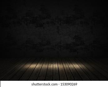 dark room with spotlight on a wood floor