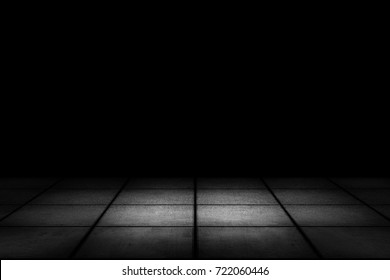 Dark room with tiled floor and black background