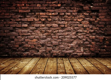 dark room with wood floor and brick wall background