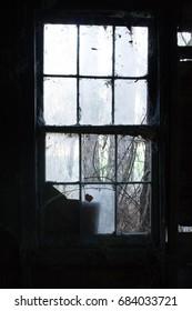 Dark, rustic window.