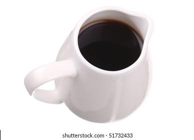 Dark sauce in white saucer isolated