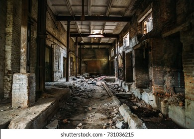 Dark scary corridor in abandoned industrial ruined brick factory, creepy interior, perspective toned