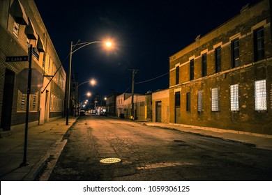 Dark and scary urban industrial city district at night