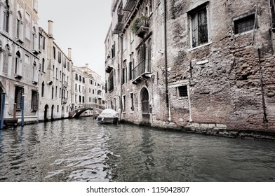 dark scene of Venice buildings and water, Italy
