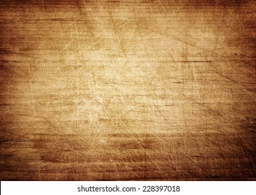 Dark scratched grunge cutting board. Wooden texture.