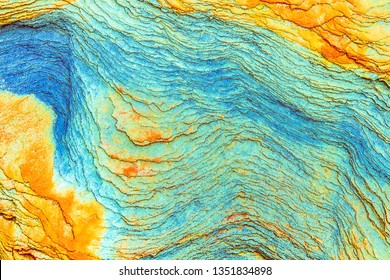 dark sedimentary rocks - colorful rock layers formed through cementation and deposition - abstract graphic design backgrounds