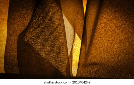 Dark sepia brown-yellow chiffon silk is a soft transparent fabric with a slight roughness (matte, crepe) due to the use of twisted yarn. Background texture
