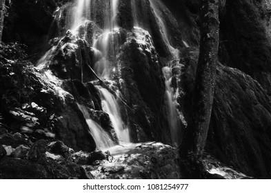 dark serene black and white waterfall background