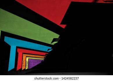 Dark shadows fallen on a colourful concrete building unique photo