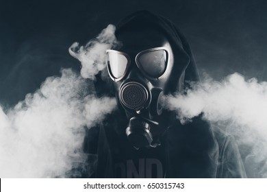 Dark side style. VAPE. The guy in a gas mask smokes VAPE.